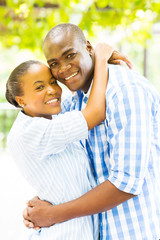 young black couple hugging