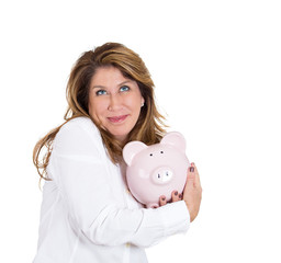 Portrait woman possessive about her savings, holding piggy bank