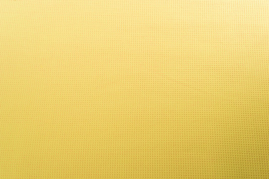 Texture of yellow cotton fabric as abstract background.