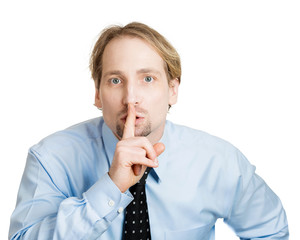 Shh. Business man asking to keep it quiet, silence please