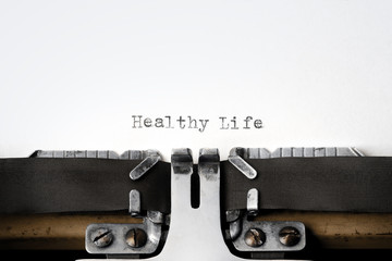 """""""Healthy Life"""" written on an old typewriter"""