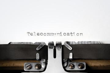 """Telecommunication"" written on an old typewriter"