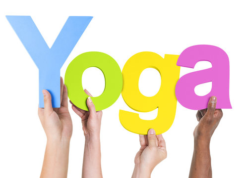 Group of Multiethnic Hands Holding Word Yoga
