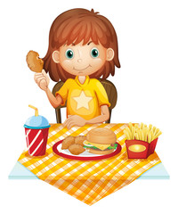 A young girl eating at the fastfood restaurant