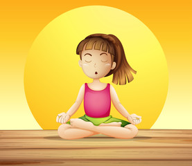 A young lady doing yoga
