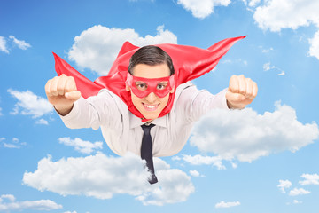 Superhero flying through the clouds in the sky