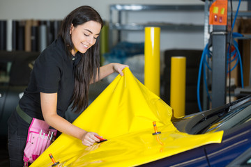 Car wrapping specialists straightening vinyl foil or film