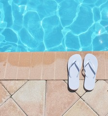 Poolside holiday vacation scenic flip flops thongs background copy space stock photo photograph image picture