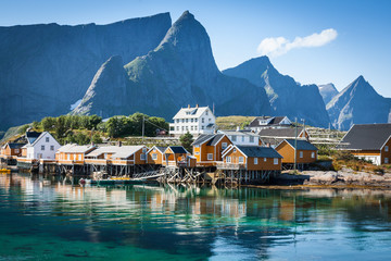 Tuinposter Scandinavië Typical Norwegian fishing village with traditional red rorbu hut