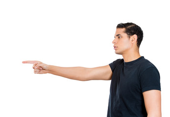 Serious young man pointing with index finger at someone