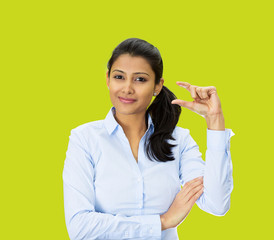 Woman showing small size hand gesture on green background