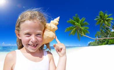 Little Girl on the Beach with Seashell Against