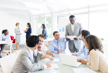 Group of Business People around Conference Table