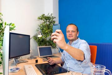 Business man taking a selfie.