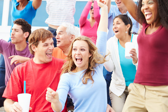 Spectators Celebrating At Outdoor Sports Event