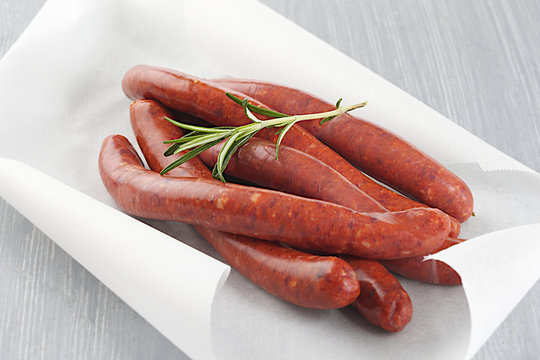 Lamb sausage with rosemary_string in baking paper