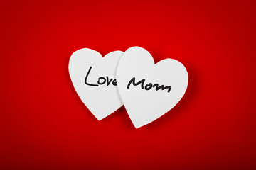 Paper heart shape symbol for mother's day