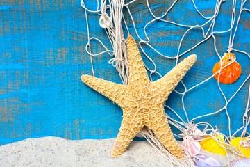 Wall Mural - Sommermotiv - Seestern mit Fischernetz