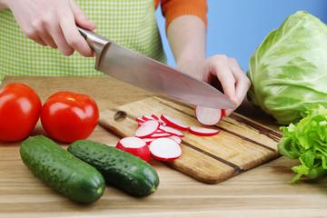 Female hands cutting celery