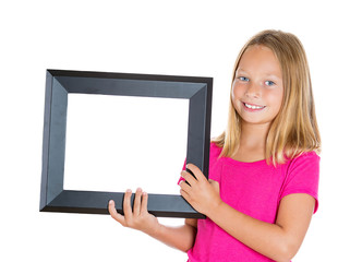 Happy girl displaying frame isolated on white background