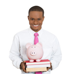 Higher education costs. Student holding books and piggy bank