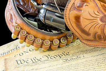 Old western pistol and gun belt with bullets
