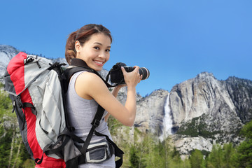 woman mountain hiker taking pictures in Yosemite