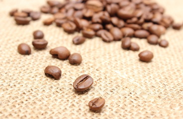 Coffee grains on jute background