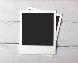 Instant photos on white plank
