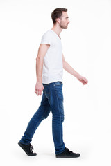 Full portrait of walking man in white t-shirt casuals.