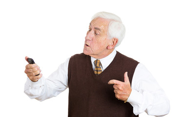 Portrait angry old man pissed off at a phone conversation