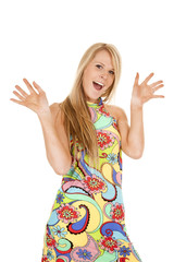 woman colorful dress hands up