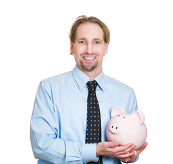 Successful businessman holding piggy isolated white background