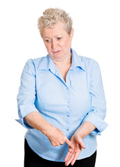 old woman guilty about something regretful looking down