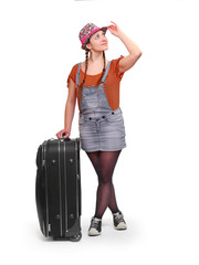 Teenage girl going on vacation with her suitcase.
