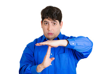 Man demanding to pause, giving time out gesture with hands