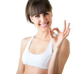 sport young woman with perfect body show ok gesture, fitness gir