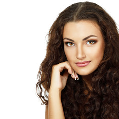 Beauty of young fresh woman with long brown healthy curly hair.
