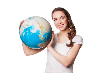 pretty smiling young lady holding a world globe. isolated on