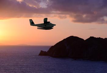 Seaplane over exotic island