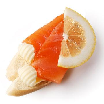 Sandwich with salmon and lemon slice