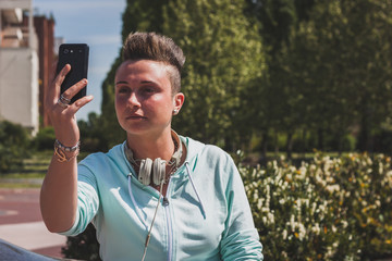 Portrait of a short hair girl taking a selfie
