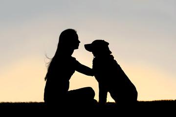 Woman Sitting Outside Petting German Shepherd Dog Silhouette