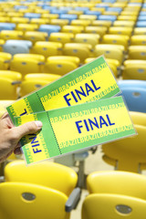Soccer Fan Holding Final Brazil Tickets at the Stadium