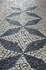 Portuguese traditional patterned cobblestones in Lagos Portugal