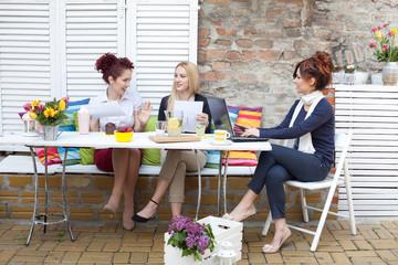 Three business women on a coffee break