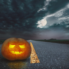 Halloween night background on the road