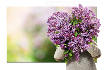 Holding A Heart-Shaped Bunch Of Lilac