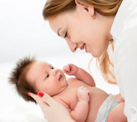 mom holding newborn baby infant