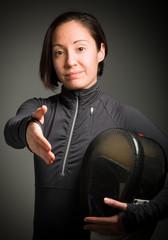Female fencer offering hand for handshake